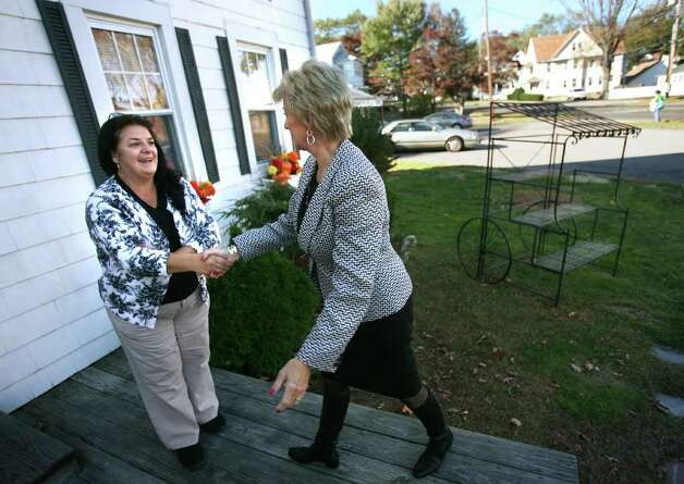 Owner Alice Dinihanian Arcuri, left, welcomes US Senate candidate Linda McMahon to Booth House of Flowers at 27 Nichols Avenue in Stratford on Tuesday, October 25, 2011. Photo: Brian A. Pounds / Connecticut Post