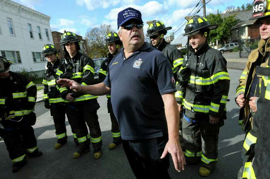 Lt. Bill Krug, center, instructs new recruits on the Albany Fire Department during a fire training drill on Tuesday, Oct. 25, 2011, in Albany, N.Y. (Cindy Schultz / Times Union) Photo: Cindy Schultz / 00015107A