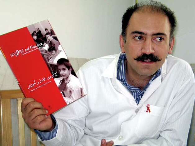Dr. Arash Alaei, the main architect of Iran's acclaimed national HIV-prevention program, displays the awareness booklet he helped create for distribution among Iranian high school students. He said it took 30 rounds of negotiation with government officials to make the book modest enough for Iran's conservative Islamic government to support. (Hannah Allam/KRT) Photo: HANNAH ALLAM / KRT