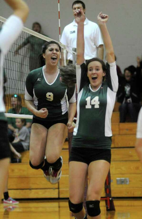 Brenham setter Hannah Baker (9) and Emily Tolliver (14) celebrate a Cubette point against Waller. Photo: Jerry Baker, For The Chronicle