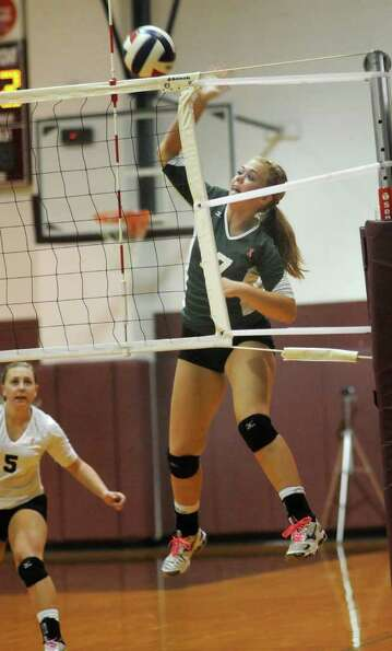 Brenham's Sydney Wellmann goes up for a kill.