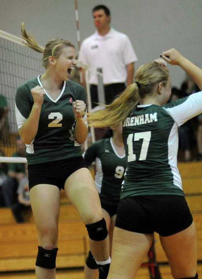 Brenham's Kat Frederick (2) and teammate Sydney Wellmann (17) celebrate a point against Waller. Photo: Jerry Baker, For The Chronicle