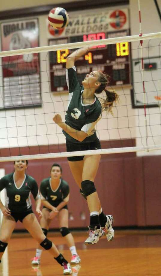 Brenham's Kelsey Weynand (3) goes up for a kill. Photo: Jerry Baker, For The Chronicle