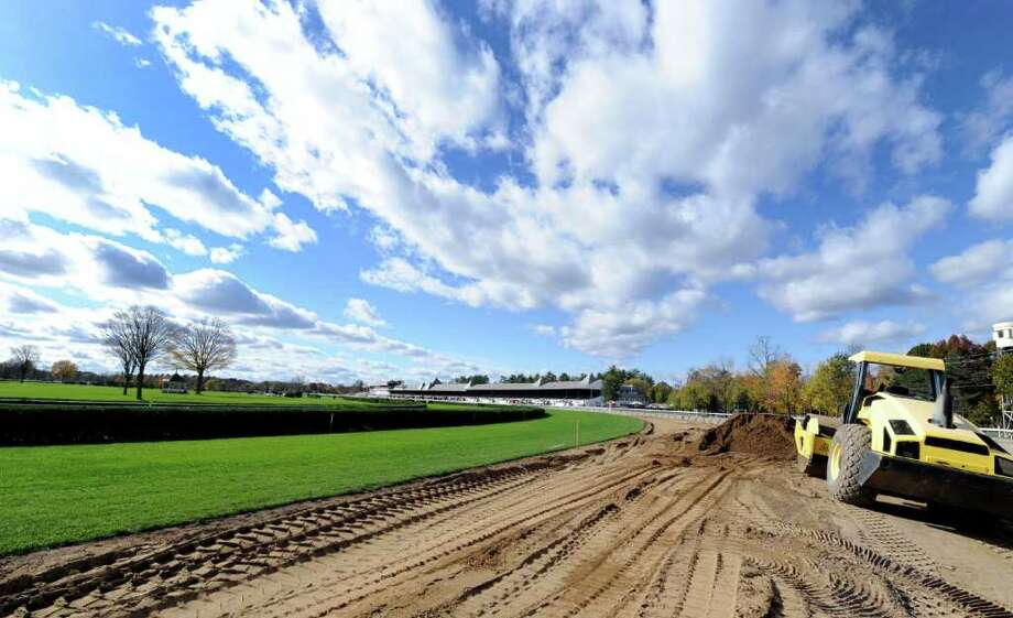 Work crews widen the main turf course at the Saratoga Race Course in Saratoga Springs, N.Y. October 25, 2011.    (Skip Dickstein / Times Union) Photo: SKIP DICKSTEIN / 2011