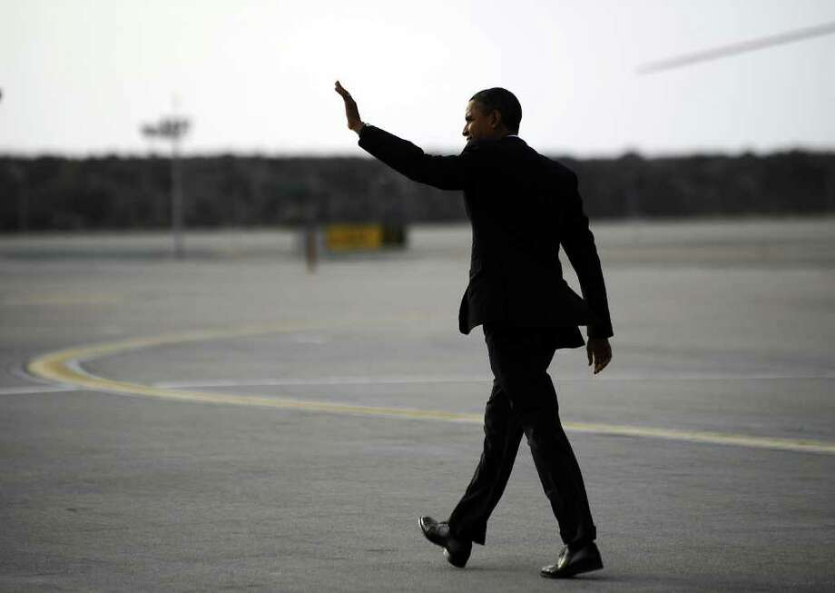 US President Barack Obama waves after disembarking from Air Force One at the Los Angeles International Airport in Los Angeles, California, on October 24, 2011. Obama said the vast majority of Americans would see a tax cut under the bill -- a $447 billion proposal aimed at reviving economic growth and curbing 9.1 percent unemployment. The White House has touted the jobs bill as a shot-in-the-arm for the economy, and accused Republicans of playing politics by blocking it. AFP Photo/Jewel Samad (Photo credit should read JEWEL SAMAD/AFP/Getty Images) Photo: JEWEL SAMAD / AFP
