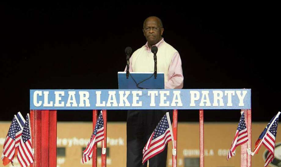 Presidential candidate Herman Cain speaks during the Clear Lake Tea Party Rally at Gulf Greyhound Park Tuesday, Oct. 25, 2011, in La Marque. Photo: James Nielsen, Chronicle / © 2011 Houston Chronicle