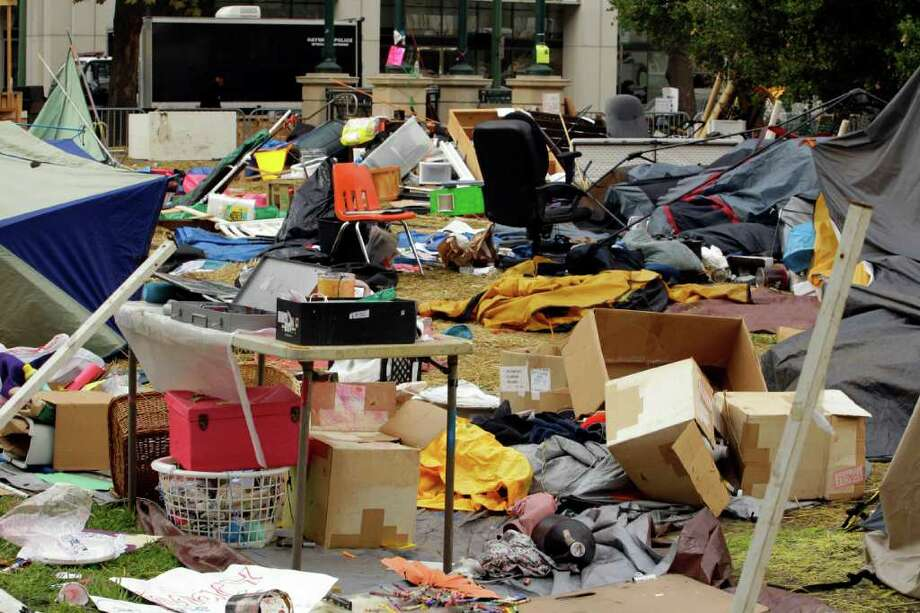 The possessions of Occupy Oakland protestors are seen strewn about Frank H. Ogawa plaza Tuesday, Oct. 25, 2011, in Oakland, Calif.  Occupy Oakland protestors were evicted from the plaza early this morning. (AP Photo/Ben Margot) Photo: Ben Margot