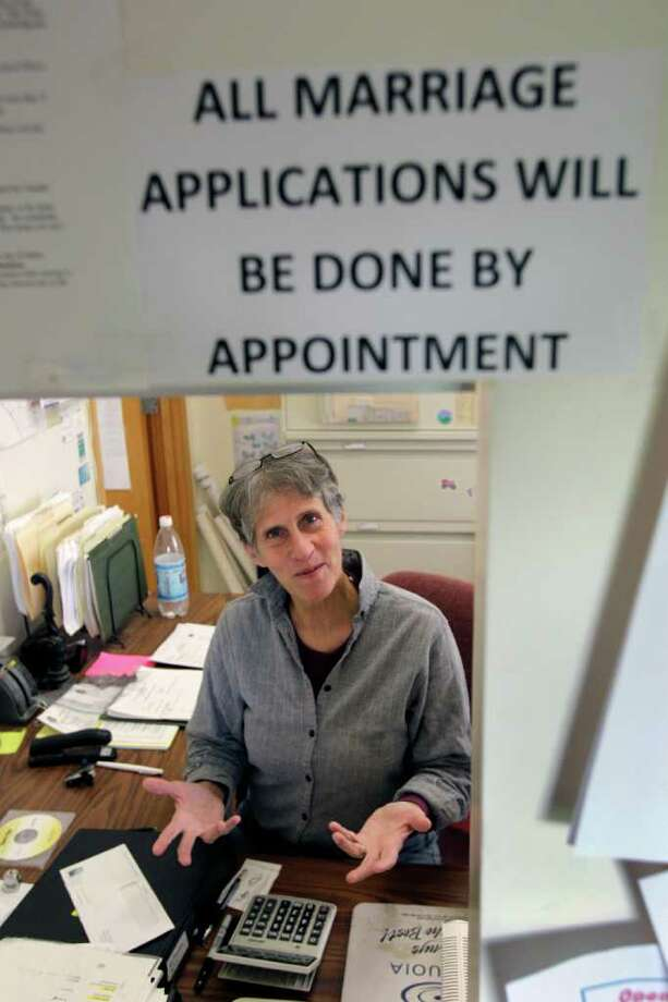 Ledyard town clerk Rose Marie Belforti poses for a photo at her office in Ledyard, N.Y., Tuesday, Oct. 18, 2011.   Shortly after New York became the largest state to sanction gay marriage this summer,  Belforti told town board members her Christian beliefs preclude her from issuing licenses to same-sex couples. She now has her office issue all marriage licenses by appointment so a deputy can handle them. (AP Photo/David Duprey) Photo: David Duprey