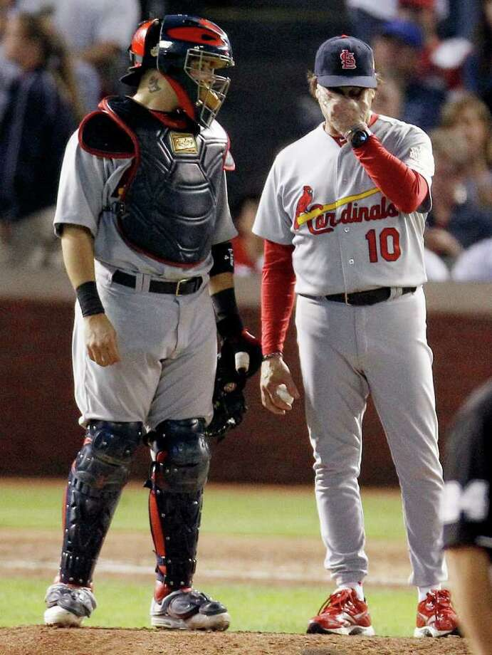St. Louis Cardinals' Yadier Molina, left and Tony La Russa wait for relief pitcher Jason Motte to enter the game during the eighth of Game 5 of baseball's World Series against the Texas Rangers Monday, Oct. 24, 2011, in Arlington, Texas. (AP Photo/Eric Gay) Photo: Eric Gay