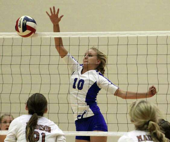 MacArthur's Claire Scharper (10) pops back a shot against Madison in volleyball at Littleton Gym on Tuesday, Oct. 25, 2011. MacArthur defeated Madison in 5 games to knock out Madison from the playoffs. Photo: Kin Man Hui, Kin Man Hui/San Antonio Express-News / San Antonio Express-News