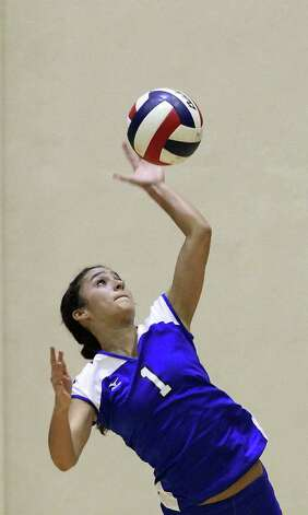 MacArthur's Mirranda Barrera (01) serves up a point against Madison in volleyball at Littleton Gym on Tuesday, Oct. 25, 2011. MacArthur defeated Madison in 5 games to knock out Madison from the playoffs. Photo: Kin Man Hui, Kin Man Hui/San Antonio Express-News / San Antonio Express-News