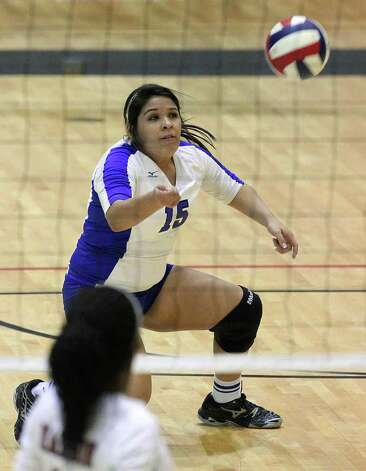 MacArthur's Tina Lopez (15) makes a save during a point against Madison in volleyball at Littleton Gym on Tuesday, Oct. 25, 2011. MacArthur defeated Madison in 5 games to knock out Madison from the playoffs. Photo: Kin Man Hui, Kin Man Hui/San Antonio Express-News / San Antonio Express-News