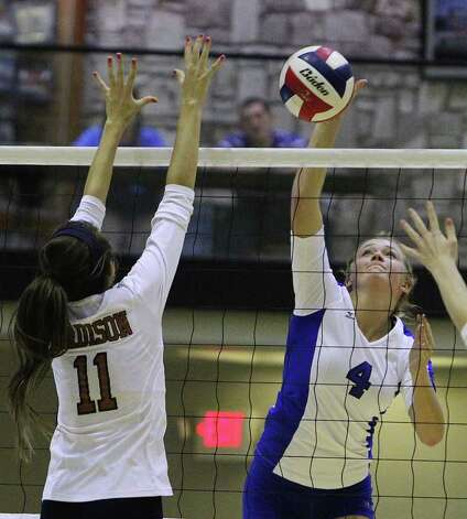 MacArthur's Taylor Bazajou (04) attempts a shot against Madison's Erica Skipper (11) in volleyball at Littleton Gym on Tuesday, Oct. 25, 2011. MacArthur defeated Madison in 5 games to knock out Madison from the playoffs. Photo: Kin Man Hui, Kin Man Hui/San Antonio Express-News / San Antonio Express-News