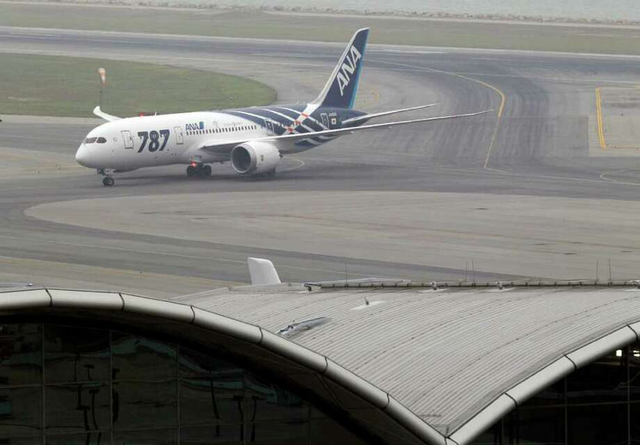 An All Nippon Airways Boeing 787 lands at Hong Kong International Airport for the airplane's inaugural commercial flight from Japan, on Wednesday. The jet, nicknamed The Dreamliner by Boeing was flown by Japan's All Nippon Airways and was packed with aviation reporters and enthusiasts — some of whom paid thousands of dollars for the privilege. Photo: AP