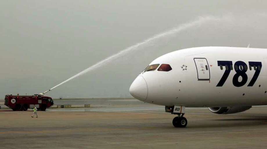 An All Nippon Airways Boeing 787 is sprayed water to celebrate its inaugural commercial flight from Japan, at Hong Kong International Airport on Wednesday. The jet, nicknamed The Dreamliner by Boeing, was flown by Japan's All Nippon Airways and was packed with aviation reporters and enthusiasts — some of whom paid thousands of dollars for the privilege. Photo: AP
