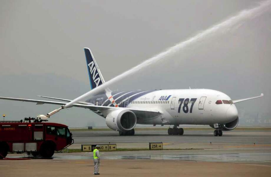 An All Nippon Airways Boeing 787 is sprayed water to celebrate the airplane's inaugural commercial flight from Japan, at Hong Kong International Airport on Wednesday. The jet, nicknamed The Dreamliner by Boeing, was flown by Japan's All Nippon Airways and was packed with aviation reporters and enthusiasts — some of whom paid thousands of dollars for the privilege. Photo: AP