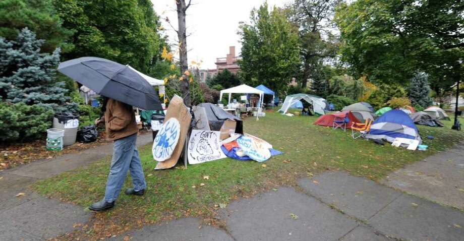 Ray Drake walks through the encampment at the Occupy Albany tent city in Academy Park in Albany, N.Y. October 26, 2011. (Skip Dickstein/Times Union) Photo: Skip Dickstein / 2011