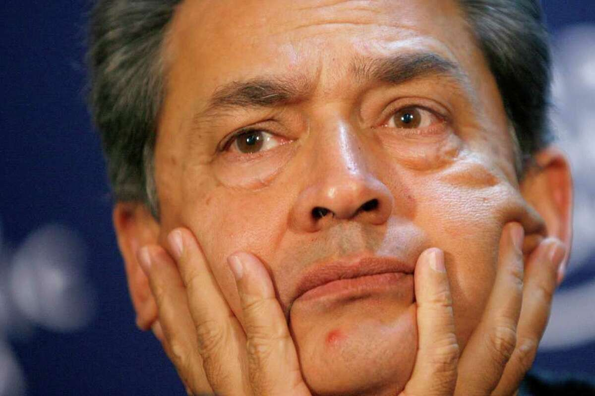 FILE - In this Jan. 3, 2009 file photo, Rajat Kumar Gupta, former Chairman of Global Fund to Fight AIDS, Tuberculosis and Malaria, listens to a statement, during a session at the World Economic Forum in Davos, Switzerland. Gupta, former Goldman Sachs board member, surrendered to federal authorities Wednesday, Oct. 26, 2011 in New York to face criminal charges stemming from a massive hedge fund insider trading case. (AP Photo/Keystone/Alessandro Della Bella, File)