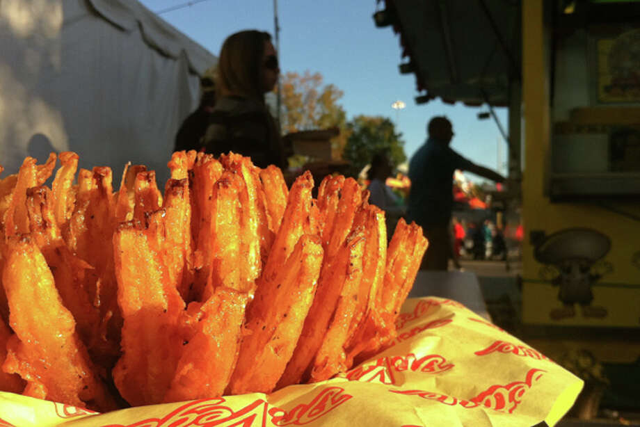 A fried blooming onion is shown at The Big E in West Springfield, Massachusetts, on Sunday, September 18, 2011. Photo: Brett Mickelson, Brett Mickelson / Hearst Connecticut Media Group / The News-Times