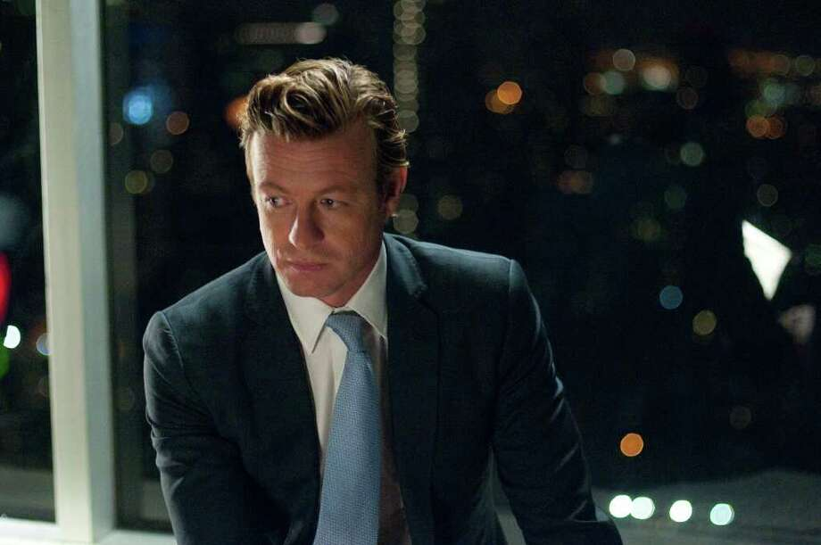 """In """"Margin Call, """"Simon Baker plays a Wall Street executive who is totally detached from any emotion when it comes to investing in the stock market. Photo: Walter Thomson, LIONSGATE / © Walter Thomson"""