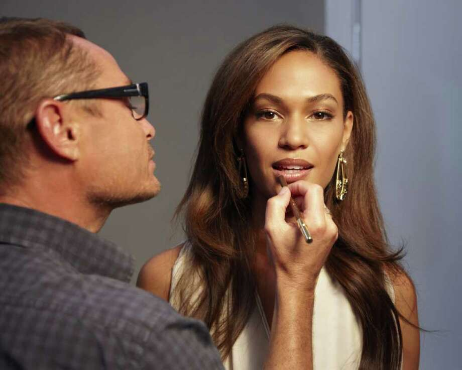 Estée Lauder creative makeup director Tom Pecheux applies finishing touches to the company's first Latina spokesmodel, Joan Smalls of Puerto Rico. Photo: ESTÉE LAUDER / Estee Lauder