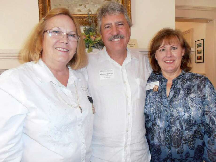 Linda and Michael Daniels (from left) owners of one of six homes on the 2011 Monte Vista Home Tour, chat with Jane Lewis, tour co-chair with Linda Daniels.