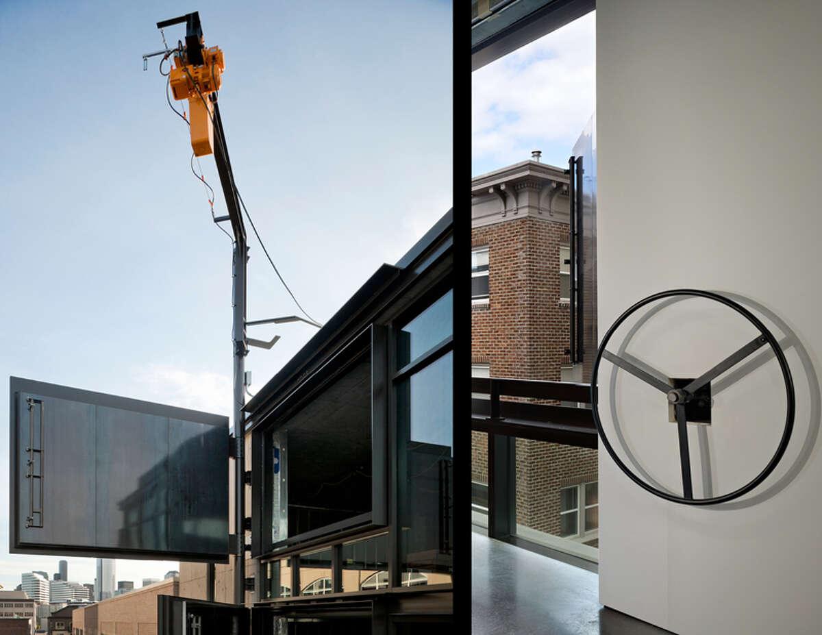 A close-up view of the door, crane and door-opening wheel of Art Stable.