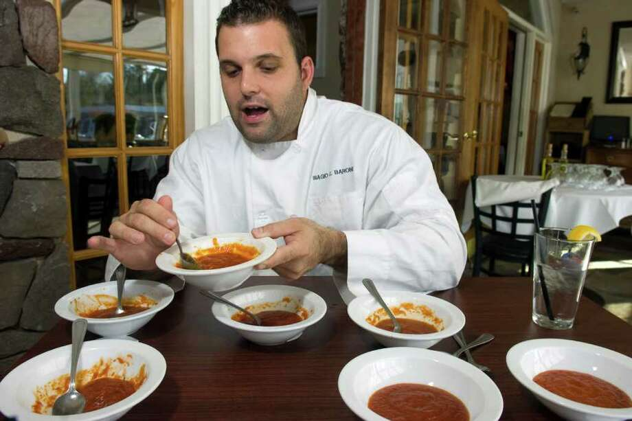 Chef Biagio Barone samples jarred marinara sauces at his restaurant, Biagio's Osteria, in Stratford, Conn. Oct. 17th, 2011. Photo: Ned Gerard / Connecticut Post