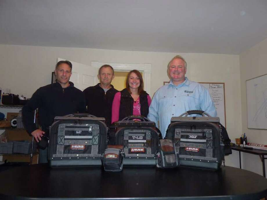 Roger Brouard, second from left, founder and chief executive officer of Veto Pro Pac in Norwalk, has turned an idea to make work as a carpenter easier into a business. Joining him in displaying his newest tool-carrying bags are from left, staff members, James Brooks, international sales and marketing; Jill Flint, sales and operations manager; and Rob Wolter, president. Photo: Contributed Photo