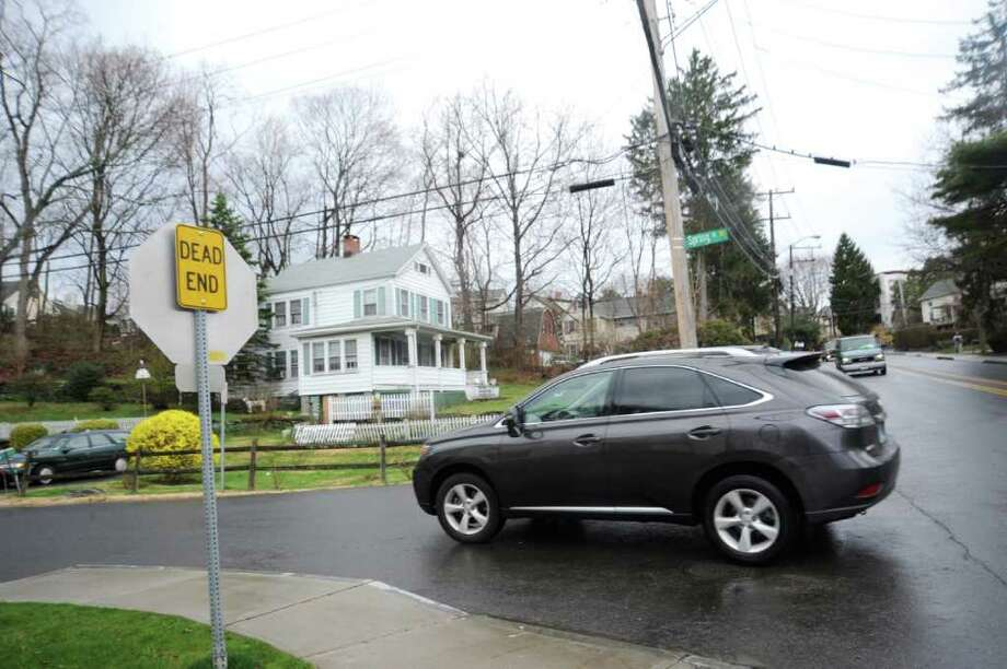A Lexus Drives Down Spring Street On April 12, 2011. Spring Street Is  Parallel