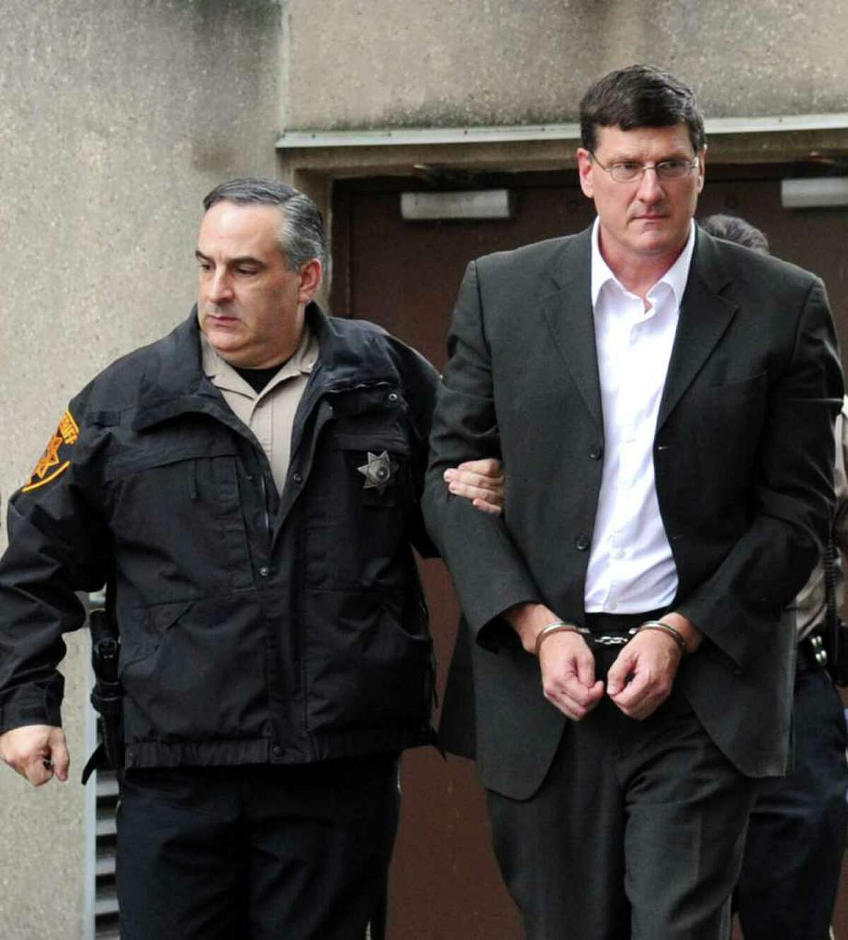 Scott Ritter, former chief United Nations weapons inspector, right, is led from the Monroe County courthouse in Stroudsburg, Pa., on Wednesday, October 26, 2011. Ritter was sentanced to 18-66 months in state prison after being convicted of unlawful contact with a minor and other felonies. Escorting Ritter is Deputy Scott Martin from the Monroe County Sheriff's office. (AP Photo/Pocono Record, David Kidwell) MANDATORY CREDIT