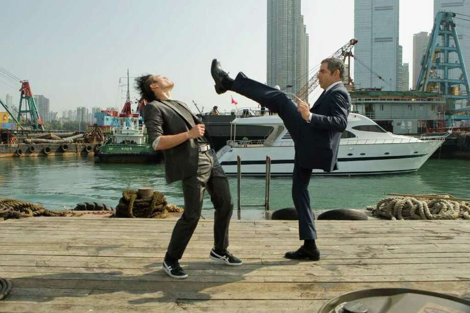 """Williams Belle (left) and Rowan Atkinson star in the spy spoof """"Johnny English Reborn."""" Photo: UNIVERSAL PICTURES"""