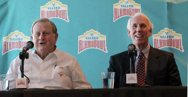"Red McCombs (left) and former Texas A&M coach R.C. Slocum (right) share a laugh during a news conference Wednesday October 26, 2011 at the Alamodome. McCombs, Slocum and others were there to introduce a new brand and marketing campaign concept for the Alamobowl with the message: ""You Never Forget the Feeling."" The marketing campaign comes from 18 years of Alamobowl college football tradition and will include promotions by use of television, print, radio, outdoor digital boards and the internet. JOHN DAVENPORT/jdavenport@express-news.net Photo: JOHN DAVENPORT, SAN ANTONIO EXPRESS-NEWS / SAN ANTONIO EXPRESS-NEWS (Photo can be sold to the public)"