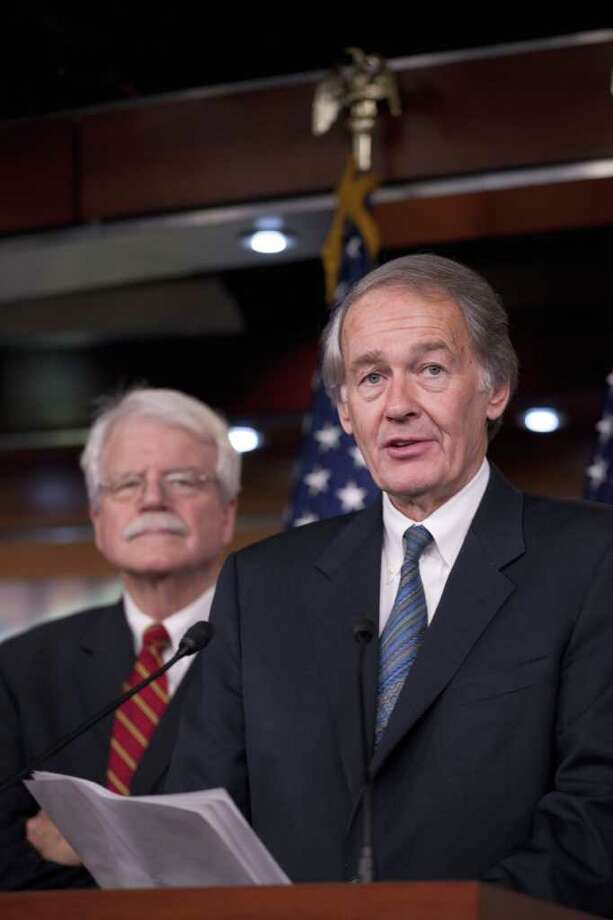 Rep. Ed Markey, D-Mass., right, accompanied by Rep. George Miller, D-Calif.,  speaks during a news conference on Capitol Hill in Washington, Wednesday, Jan. 26, 2011, to discuss the BP oil spill. (AP Photo/Harry Hamburg) Photo: Harry Hamburg / FR170004 AP