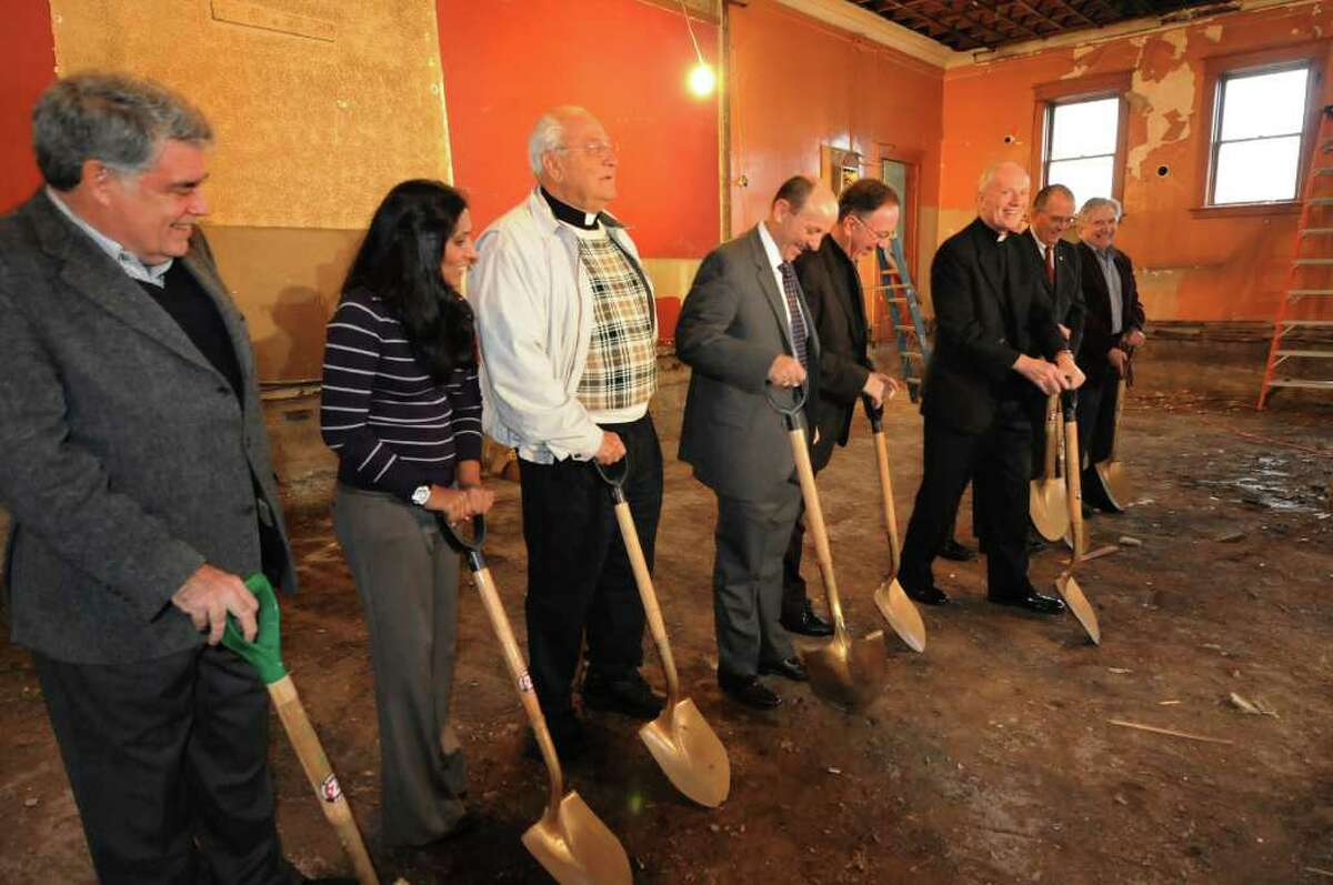 Officials man the shovel during the dedication ceremony of the Sister Maureen Joyce Center on Wednesday, Oct. 26, 2011, in Albany, N.Y. (Cindy Schultz / Times Union)