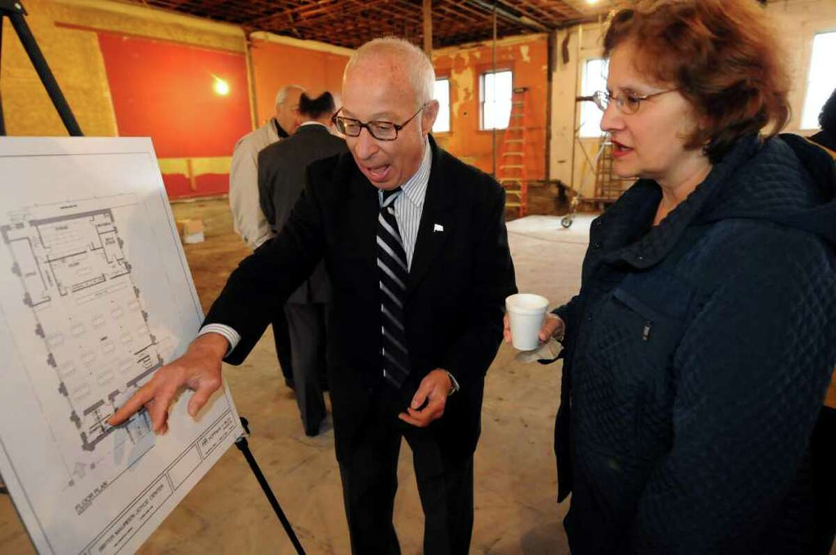 General contractor Dick Zandri of Zandri Construction Corp., left, explains the floor plan to volunteer Jackie DeSantiOfficials man the shovel during the dedication ceremony of the Sister Maureen Joyce Center on Wednesday, Oct. 26, 2011, in Albany, N.Y. (Cindy Schultz / Times Union)