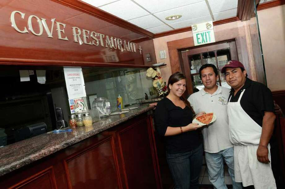Cove Pizza employees Andrea Forlenzo, Franklin Pascual and Franklin Lopez pose for a photograph inside Cove Pizza in Stamford on Wednesday, Oct. 26, 2011. Photo: Amy Mortensen / Connecticut Post Freelance