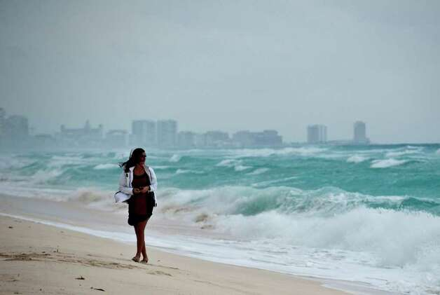 A woman walks in Playa del Carmen beach, Quintana Roo State, Mexico on October 25, 2011. Photo: RONALDO SCHEMIDT, Getty / RONALDO SCHEMIDT