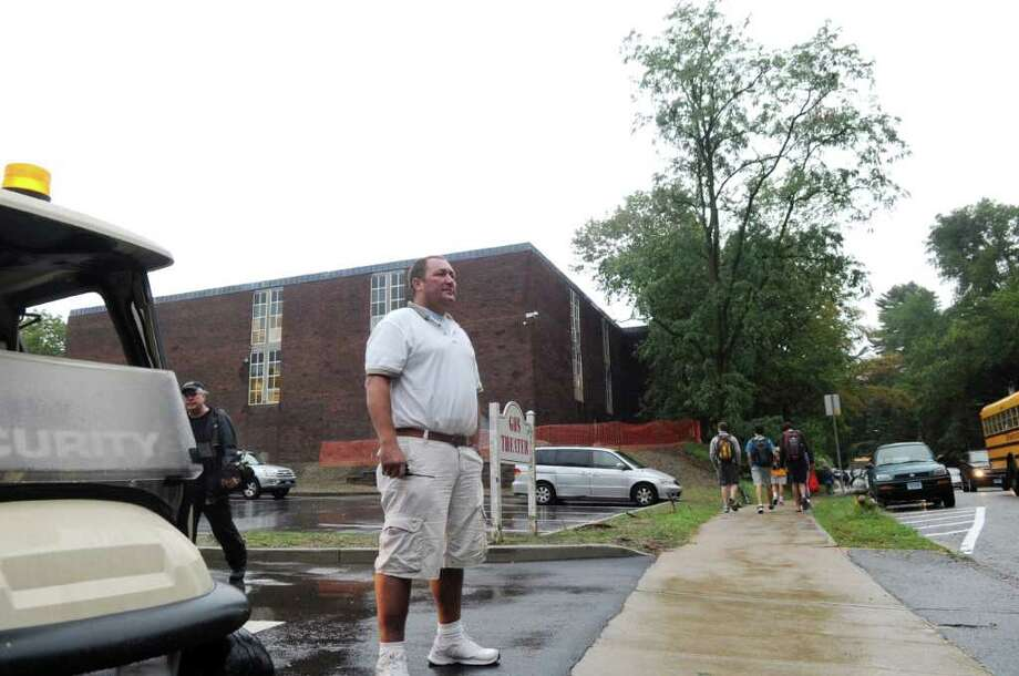 Security guard Chris Kralik directs traffic at Greenwich High School on the first day of school, on Sept. 7, 2011. Photo: Helen Neafsey, Greenwich Time File / Greenwich Time