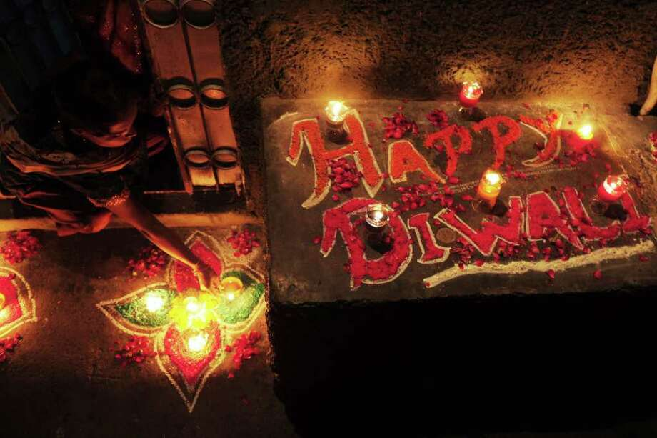 For Diwali people honor the Hindu goddess of wealth, Lakshmi, by decorating their homes with flowers and diyas (earthen lamps), and celebrate the homecoming of the God Ram after he vanquished the demon king Ravana. Photo: RIZWAN TABASSUM, Getty / AFP