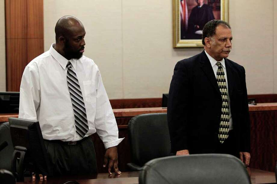 Standing next to his attorney Charles Brown, Roderick Fountain, 37, left, stands as the verdict of guilty is read for the murder of his 3-year-old son Kendrick Jackson in the 208th State District Criminal Court Wednesday, Oct. 26, 2011, in Houston. Witnesses said they saw the boy with bruises days before he disappeared on April 7, 2006, and at least one jailhouse inmate testified that Fountain confessed the crime to him. Kendrick Jackson is still missing. Photo: Johnny Hanson, Houston Chronicle / © 2011 Houston Chronicle