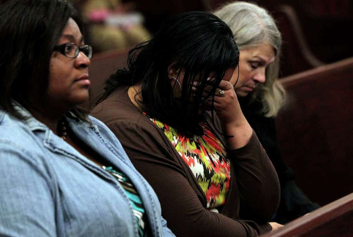 Keyanna Jackson, 27, center, reacts after the verdict is read convicting Roderick Fountain, 37, of the murder of their 3-year-old son Kendrick Jackson.