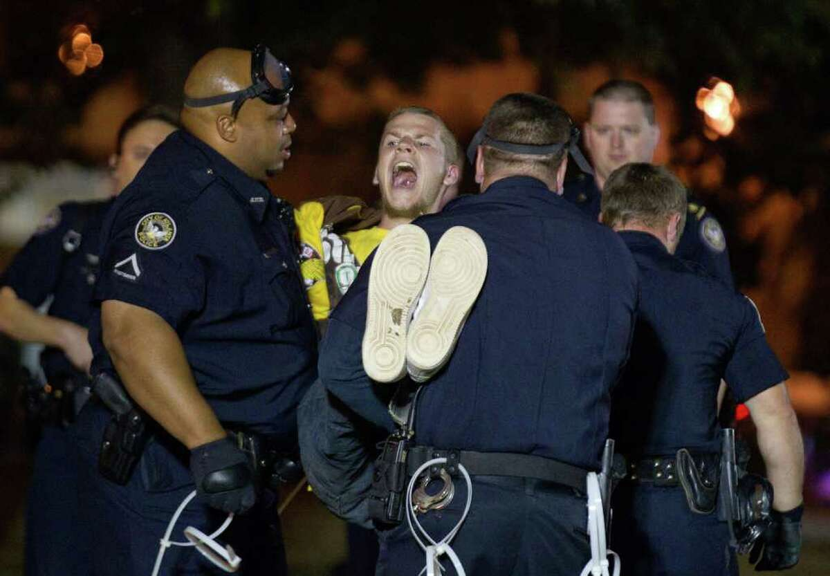 DAVID GOLDMAN: ASSOCIATED PRESS HAULED OFF: A protester of Occupy Atlanta is arrested Wednesday for refusing to leave after Mayor Kasim Reed revoked his order allowing a camp in a downtown park.