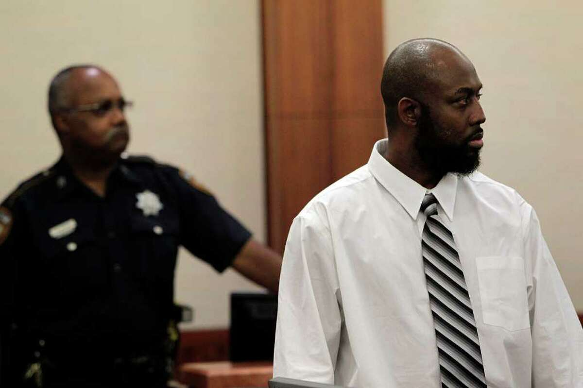 Roderick Fountain, 37, left, stands after being found guilty for the murder of his 3-year-old son Kendrick Jackson.