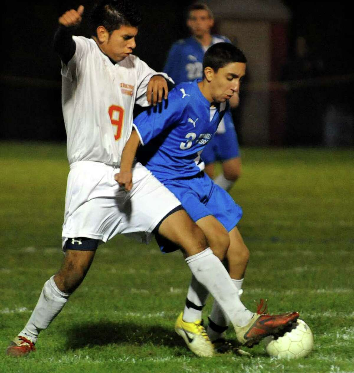 Stratford's Chris Gonzalez, left, cuts off Bunnell's #3 Anthony Amante as he goes for the ball, during boys soccer action against Stratford's in Stratford, Conn. on Wednesday October 26, 2011.