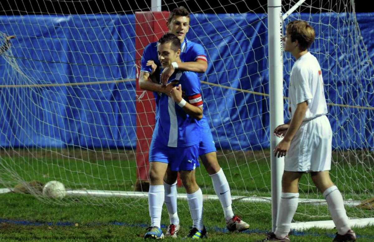 Bunnell's #7 Justin Lewis, in back, and teammate #13 Jeremy Proto, celebrate a goal by Lewis, during boys soccer action against Stratford in Stratford, Conn. on Wednesday October 26, 2011.