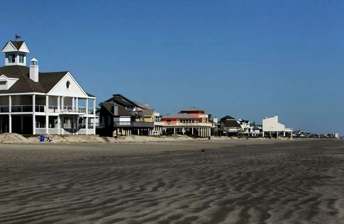 Homes sit along Pirates Beach on Galveston's West End about five miles from the city's protective seawall Wednesday, Oct. 19, 2011. A new book published by Rice University about Galveston Island questions whether anyone should live on its western end, a subject of increasing debate on the island. The book recommends that all of the human habitation be pulled back behind the sea wall. ( Johnny Hanson / Houston Chronicle )