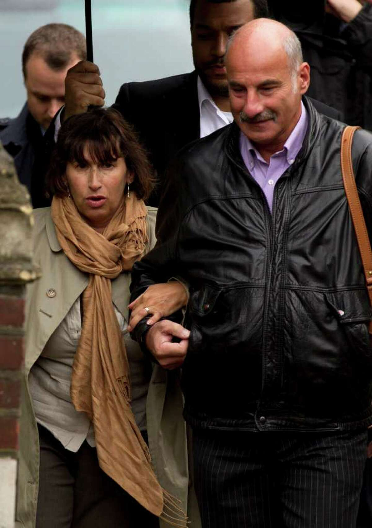 Amy Winehouse's mother Janis, left, arrives at St Pancras Coroner's Court for a hearing into the singer's death in London, Wednesday, Oct. 26, 2011. A British coroner will hear about the final hours of Amy Winehouse's life at the inquest into the soul diva's death. The singer, who had fought drug and alcohol problems for years, was found dead in bed at her London home on July 23 at age 27. (AP Photo/Matt Dunham)