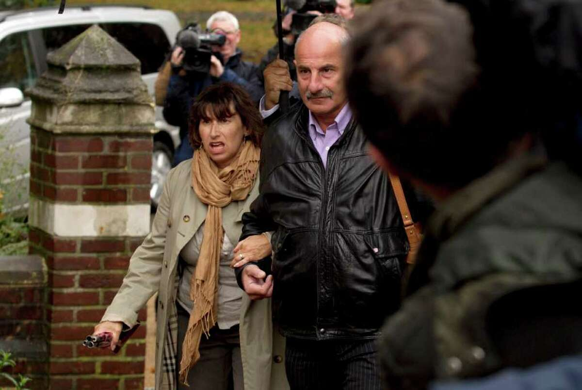 Amy Winehouse's mum Janis, left, arrives at St. Pancras Coroner's Court for a hearing into the singer's death in London, Wednesday, Oct. 26, 2011. A British coroner will hear about the final hours of Amy Winehouse's life at the inquest into the soul diva's death. The singer, who had fought drug and alcohol problems for years, was found dead in bed at her London home on July 23 at age 27. (AP Photo/Matt Dunham)