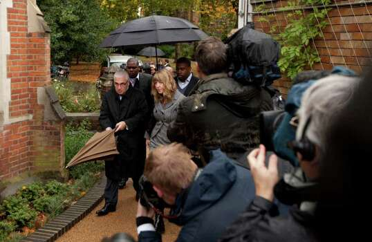 Amy Winehouse's father Mitch, left, and his partner Jane, second left, arrive at St Pancras Coroner's Court for a hearing into the singer's death in London, Wednesday, Oct. 26, 2011.  A British coroner will hear about the final hours of Amy Winehouse's life at the inquest into the soul diva's death.  The singer, who had fought drug and alcohol problems for years, was found dead in bed at her London home on July 23 at age 27.  (AP Photo/Matt Dunham) Photo: Matt Dunham / AP